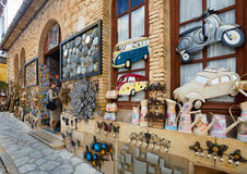 Guadalest gift stall editorial. GUADALEST, SPAIN – MAY 05, 2016: woman on summer holiday shopping in gift street stall store Royalty Free Stock Photos