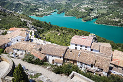 Guadalest lake and village. Reservoir and tiling roofs. Royalty Free Stock Image