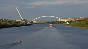 Guadalquivir river Barqueta bridge, seville. View on the guadalquivir river and the Barqueta bridge stock images