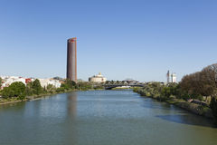 Guadalquivir river and contemporary Seville landmarks Stock Images