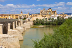 Guadalquivir River passing through Cordobas roman bridge. With the Mosque-Cathedral as background. Spain royalty free stock photos