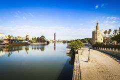 Guadalquivir River in Sevilla. Famous Golden Tower in the right. Seville is the capital of Andalusia, Spain royalty free stock images