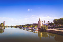 Guadalquivir River in Seville. Famous Golden Tower in the right. Seville is the capital of Andalusia, Spain royalty free stock photo