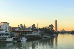 Guadalquivir river in Seville, Spain. This picture is taken in Seville. Seville is the capital and largest city of the autonomous community of Andalusia and the stock image