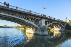 Guadalquivir river in Seville, Spain. This picture is taken in Seville. Seville is the capital and largest city of the autonomous community of Andalusia and the royalty free stock photo