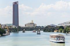Guadalquivir river, Seville Tower, Triana bridge, Seville, Spain royalty free stock photos