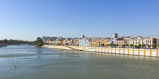 Guadalquivir river, Seville, with Triana quarter. Panoramic view of Triana quarter waterfront on the left bank of Guadalquivir river, Seville, Spain royalty free stock photos