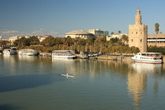 Guadalquivir river with Torre del Oro tower. In Seville royalty free stock images