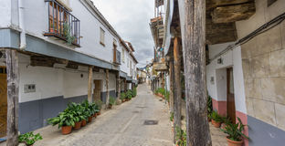 Guadalupe vintage streets with wooden columns in Spain Royalty Free Stock Photos