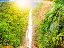Guadeloupe Carbet Falls. Carbet Falls or Les Chutes du Carbet at sunset, one of three waterfalls in tropical rainforest on Carbet River, Guadeloupe island stock image