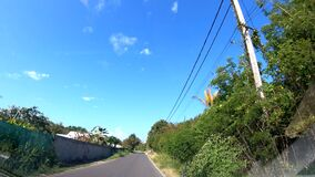 Driving on a narrow country road in Guadeloupe