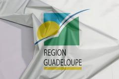Guadeloupe regionu tkaniny flagi zagniecenie z biel przestrzenią i krepa obrazy royalty free