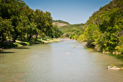 The Guadeloupe River Texas. The Guadeloupe River in New Braunsfels, the Texas Hill Country. It is famous in Texas for floating down in inner tubes and rafts stock image