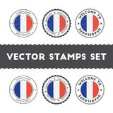 Guadeloupian flag rubber stamps set. National flags grunge stamps. Country round badges collection Royalty Free Stock Photo