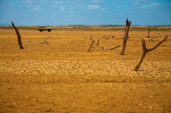 Guajira Wasteland. A view of a desolate desert with an SUV in the background Royalty Free Stock Images