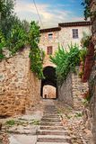 Gualdo Cattaneo, Perugia, Umbria, Italy: old alley to the entran. Gualdo Cattaneo, Perugia, Umbria, Italy: old alley with stairway and underpass to the entrance Royalty Free Stock Photography