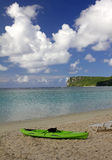 Guam Beach Kayak. Green kayak along Tumon Bay in tropical island of Guam with Two Lover's Point in the background Royalty Free Stock Photography