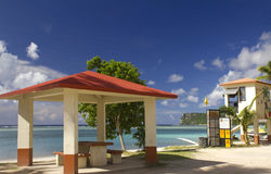 Guam Beach Picnic Shed. Picnic shed along Tumon Bay with Two Lovers Point in background in the island of Guam Stock Images