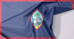 Guam fabric flag crepe and crease with white space. stock image