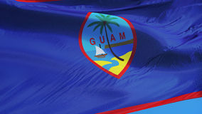 Guam flag in slow motion seamlessly looped with alpha. Guam flag waving in slow motion against clean blue sky, seamlessly looped, close up, isolated on alpha stock footage
