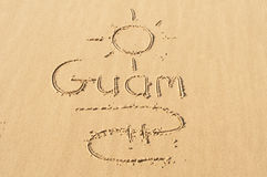 Guam in the Sand. A picture of the sun and the word Guam drawn in the sand Royalty Free Stock Image