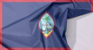 Guam tkaniny flaga zagniecenie z biel przestrzenią i krepa obraz stock