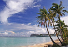 Guam Tropics. Early morning in Tumon Bay Guam with Two Lover's Point in the background Royalty Free Stock Photo