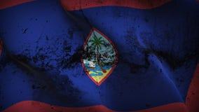 Guam US State grunge dirty flag waving on wind. stock illustration