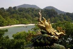 Guan Yin - Bodhisattva/ Goddess of Compassion riding on dragon. In the beautiful island Stock Image