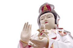 The Guan Yin Buddha. Statue postures of giving alms child Royalty Free Stock Image
