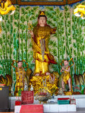 Guan Yin goddess gold. Idols statue art religion respect belief church Chinese goddess Stock Photo
