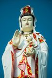 Guan Yin (The Goddess of Mercy). On blue sky Stock Photo