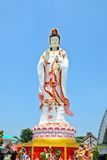 Guan Yin statue on blue sky background Royalty Free Stock Photos