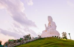 Guan Yin Statue on evening sky at Wat huay pla kang temple. Chinese temple in Chiang Rai Province,Thailand Royalty Free Stock Images