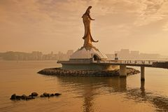 Guan Yin Statue Monument of Macau in the late evening with golden sunlight