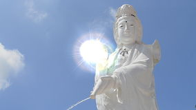 Guan Yin Statue On Nice Sky And Lighting Effect Stock Photo