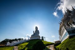 Guan Yin statue with Thai style church in Hyuaplakang temple. Thailand royalty free stock photo