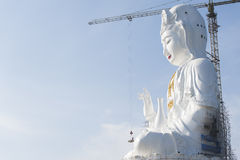 Guan Yin Statue. Under construction work and blue sky background Royalty Free Stock Photos