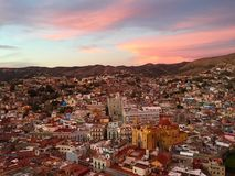 Guanajuato at dusk. Pink clouds at sunset over Guanajuato Stock Photos