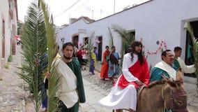 Catholic people procession celebrating the Palm Sunday. GUANAJUATO, MEX 2016 (ILLUSTRATIVE IMAGE). Catholic people procession celebrating the Palm Sunday. An stock video footage