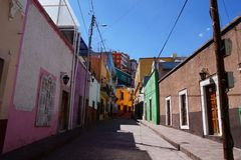 Guanajuato Mexico November 2017, colourful colonial street in the town`s center. Colonial street in the center of Guanajuato in Mexico. Empty street, colourful Royalty Free Stock Photo