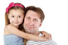 Guancica della figlia e del padre alla guancica Fotografia Stock Libera da Diritti