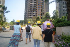 Guangdong Zhongshan, China: Housing construction site, people wear safety helmet Stock Photo