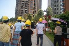Guangdong Zhongshan, China: Housing construction site, people wear safety helmet Royalty Free Stock Photos