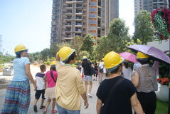 Guangdong Zhongshan, China: Housing construction site, people wear safety helmet Stock Photography