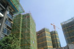 Guangdong Zhongshan, China: many-storied buildings under construction Stock Photography