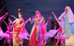 Guangxi Cultural Week. SHANGHAI - AUGUST 4: Artists, in colorful costumes, perform on stage during Dancing and singing performance event as a part of the Guangxi Royalty Free Stock Photos