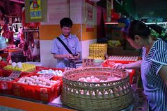 GUANGZHOU, CHINA - CIRCA MAY 2018: A woman chooses eggs in the market. stock image