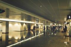 Guangzhou, China - June 25, 2018: Long lighted corridor at Guangzhou airport. royalty free stock photo