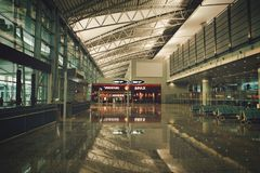 Guangzhou, China - June 25, 2018: Semi-empty bright hall in a modern airport. royalty free stock photo